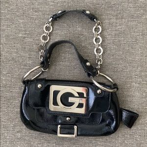 Guess black patent Clutch